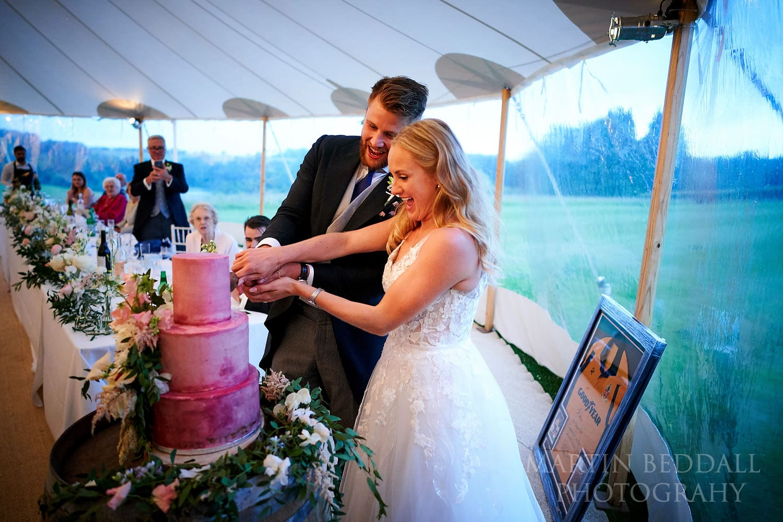 Cutting the wedding cake at Buckhurst Park wedding