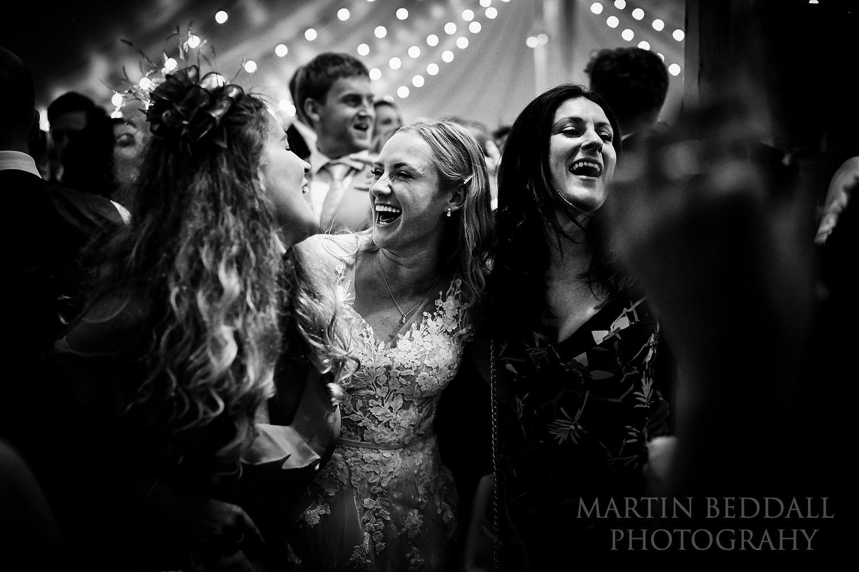 Bride on the dance floor with her friends at Buckhurst Park wedding