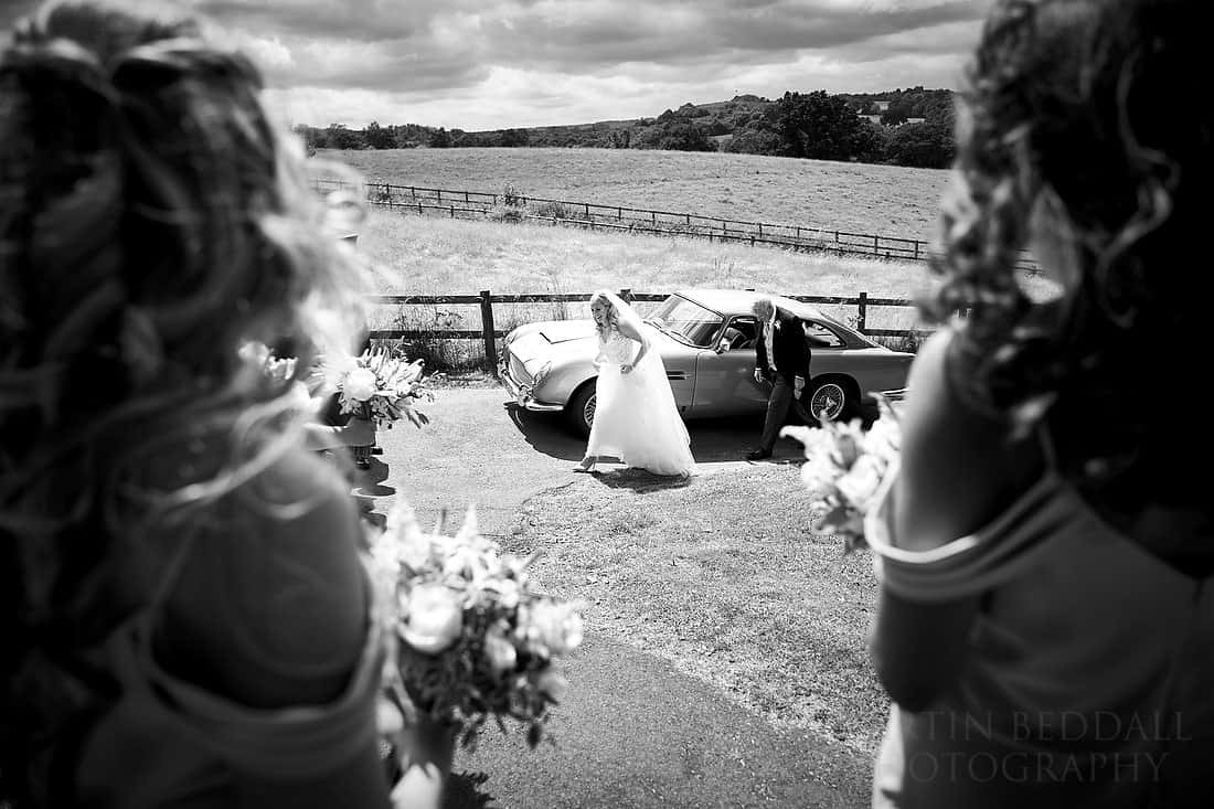 Bride arrives in an Aston Martin DB5