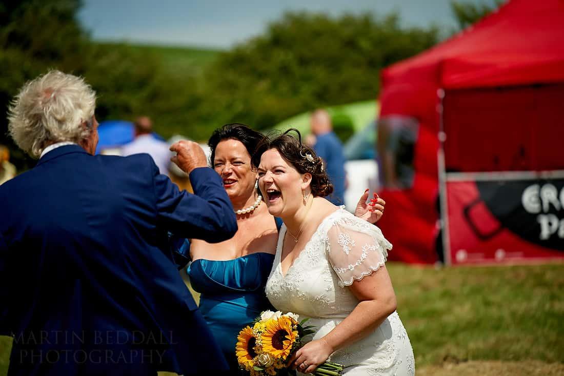 bride jokes with her parents