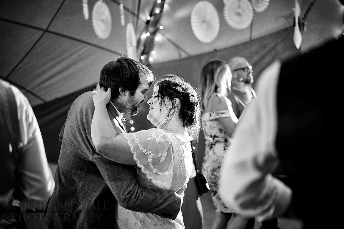 bride and groom dancing in the tipi