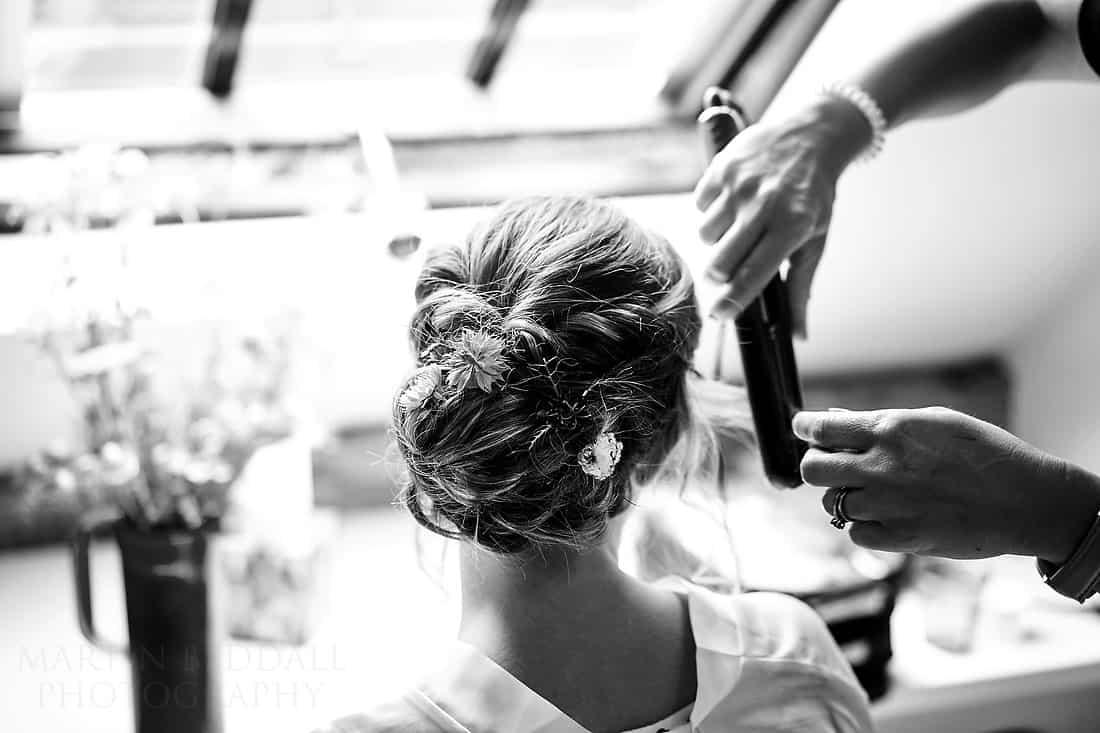 Final tweaks to the bride's hair