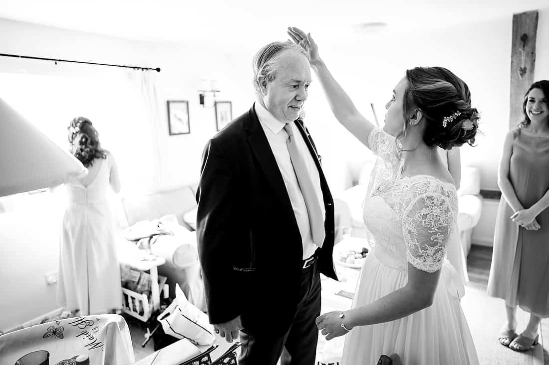 Bride flattens her father's hair