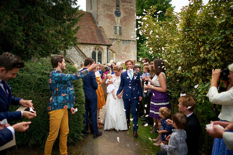 Confetti at Sussex village wedding