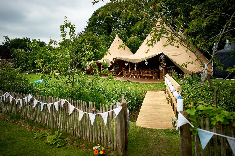 Tipi setup at Sussex village wedding