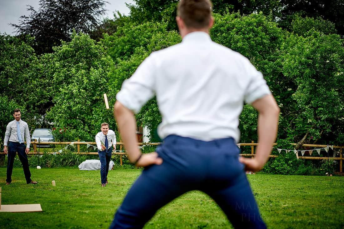 palying Kubb at a wedding reception