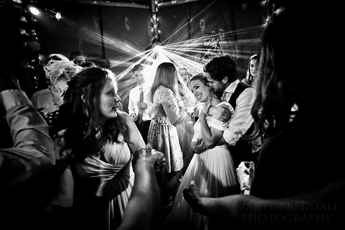 bride and groom hug on the dance floor