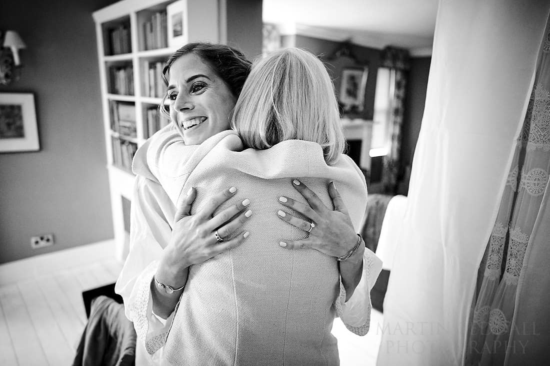 bride hugs her mother