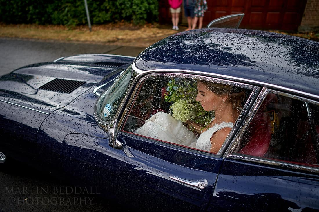 bride arrives in e-type jag