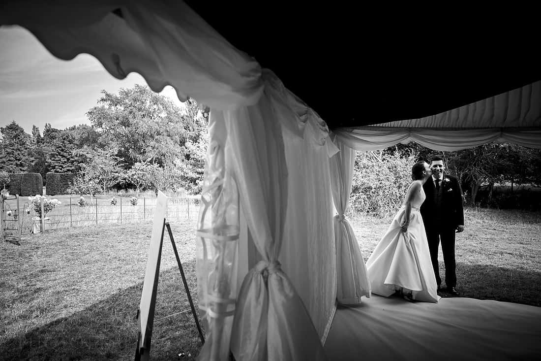 a kiss before entering the marquee