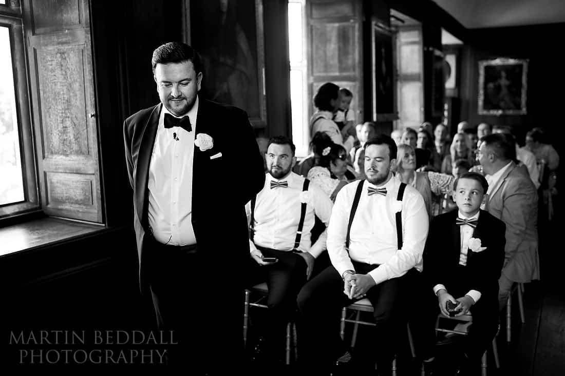 Groom waits in the ceremony room