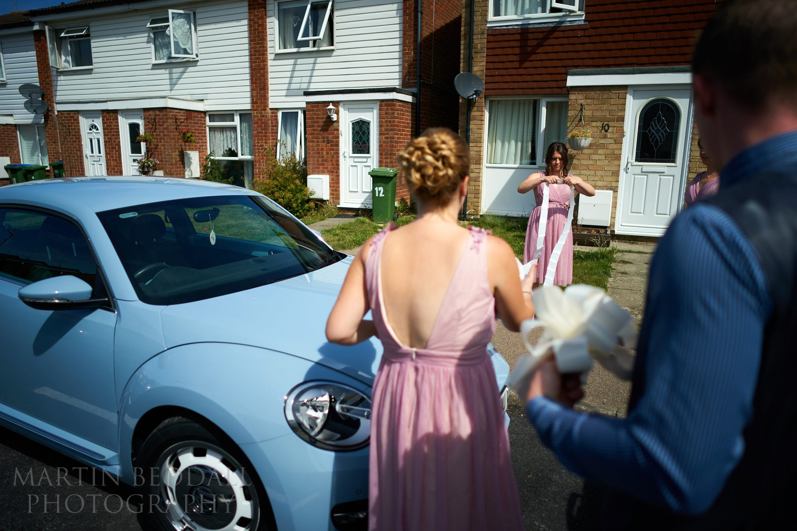 Putting tape on the wedding car