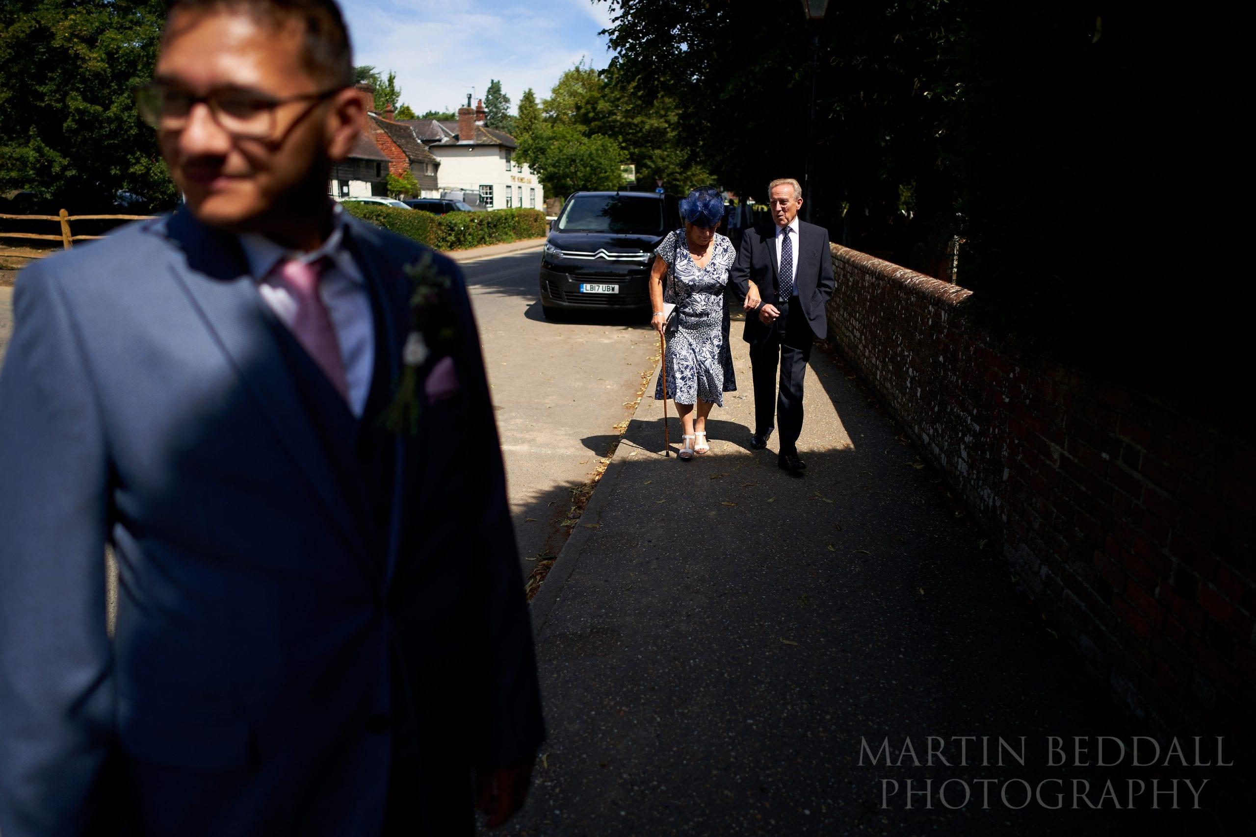 Wedding guests arrive at Warnham church in West Sussex