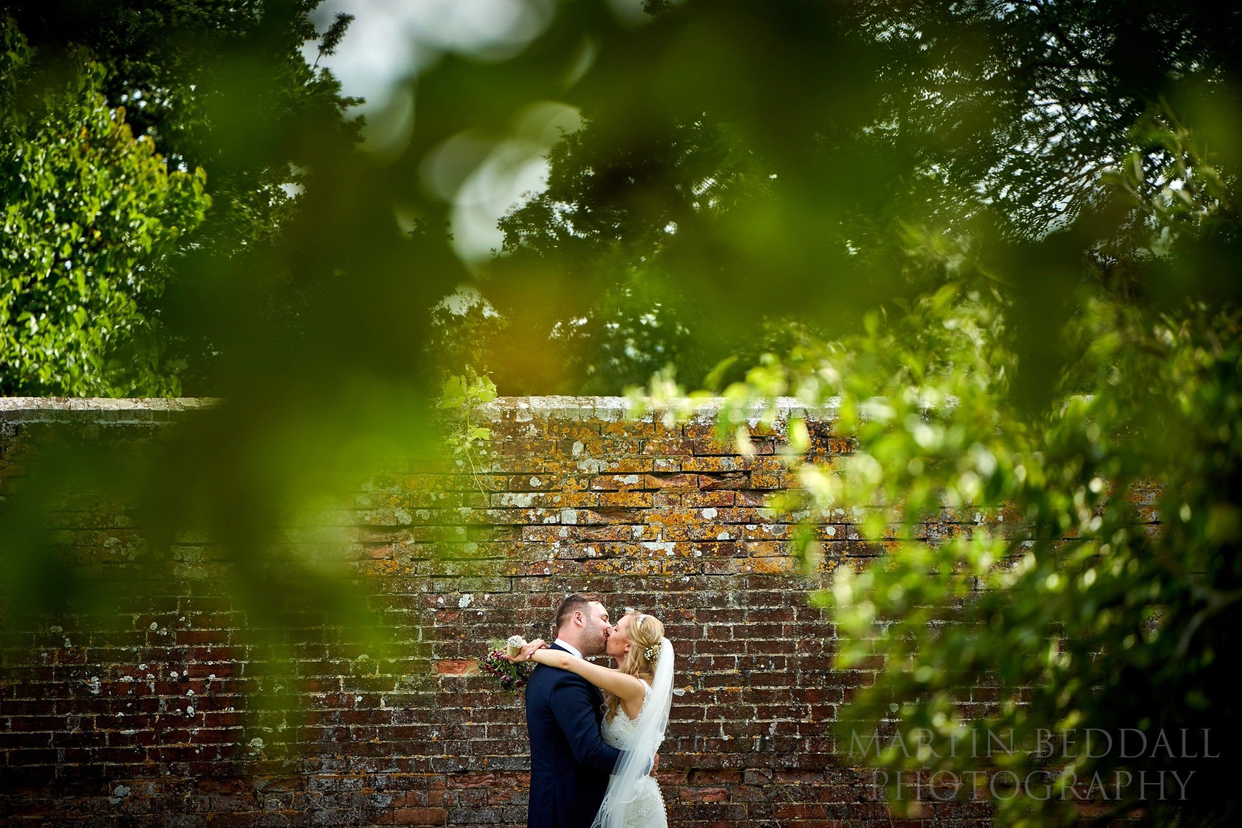 Secret Barn wedding portrait kiss