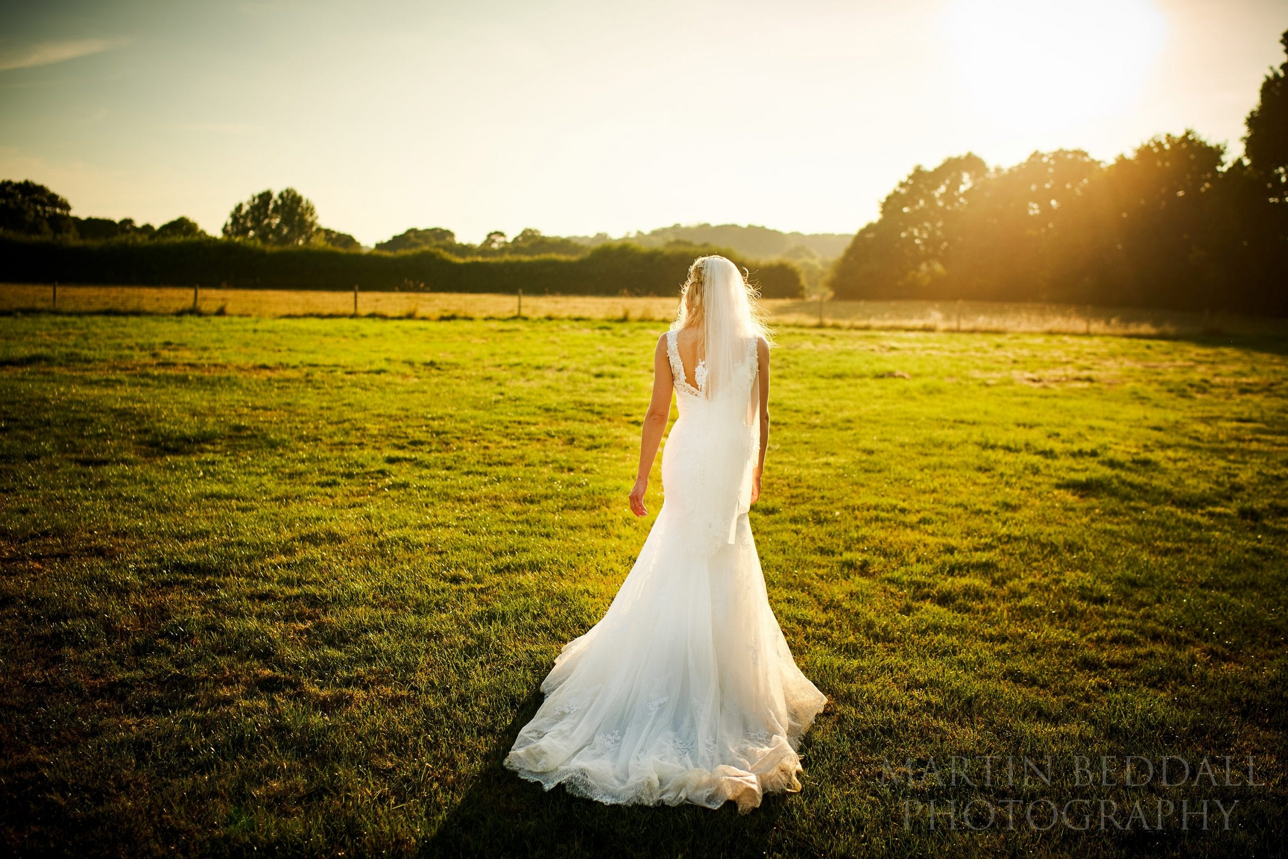 Picture of the bride on a summer evening at The Secret Barn in Sussex