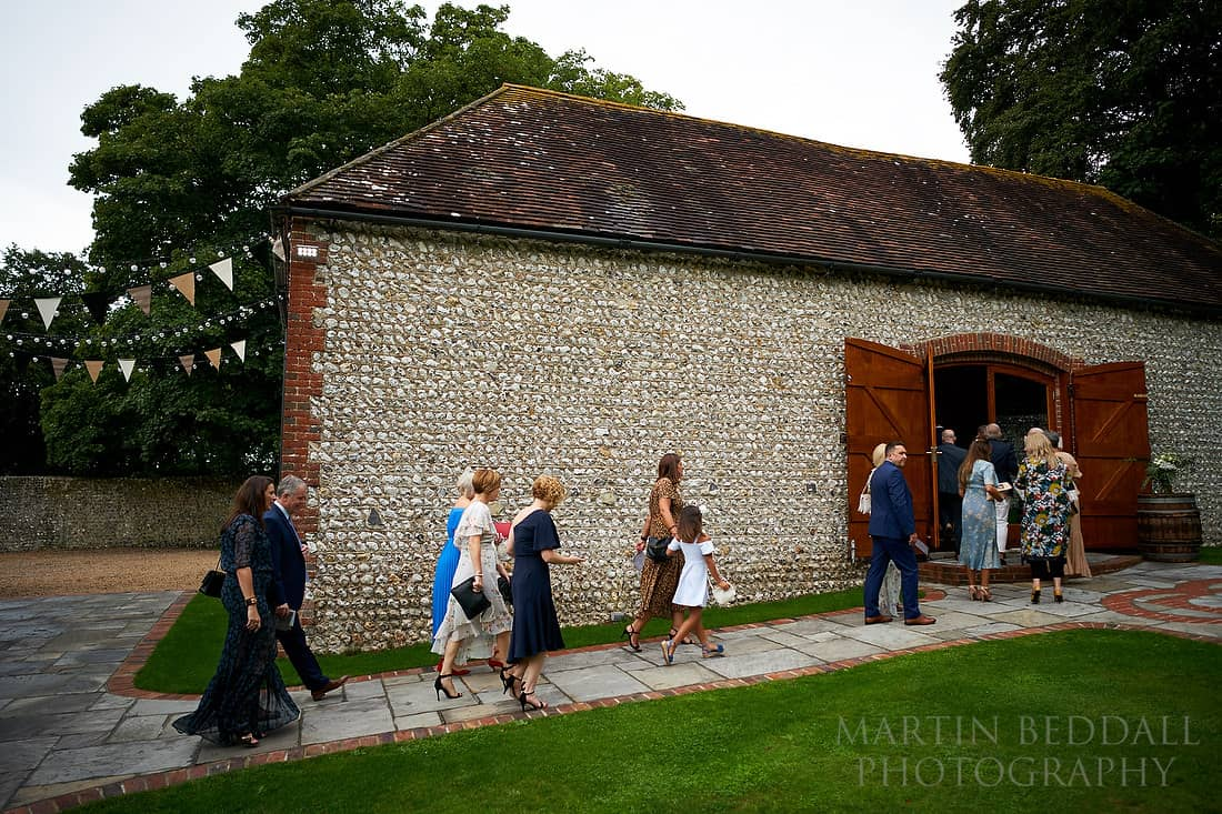 guests head into the ceremony barn