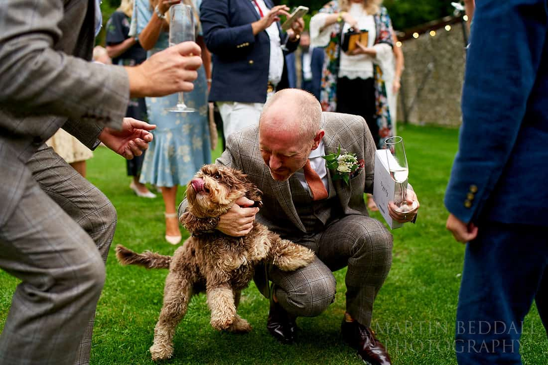 grooms and their dog