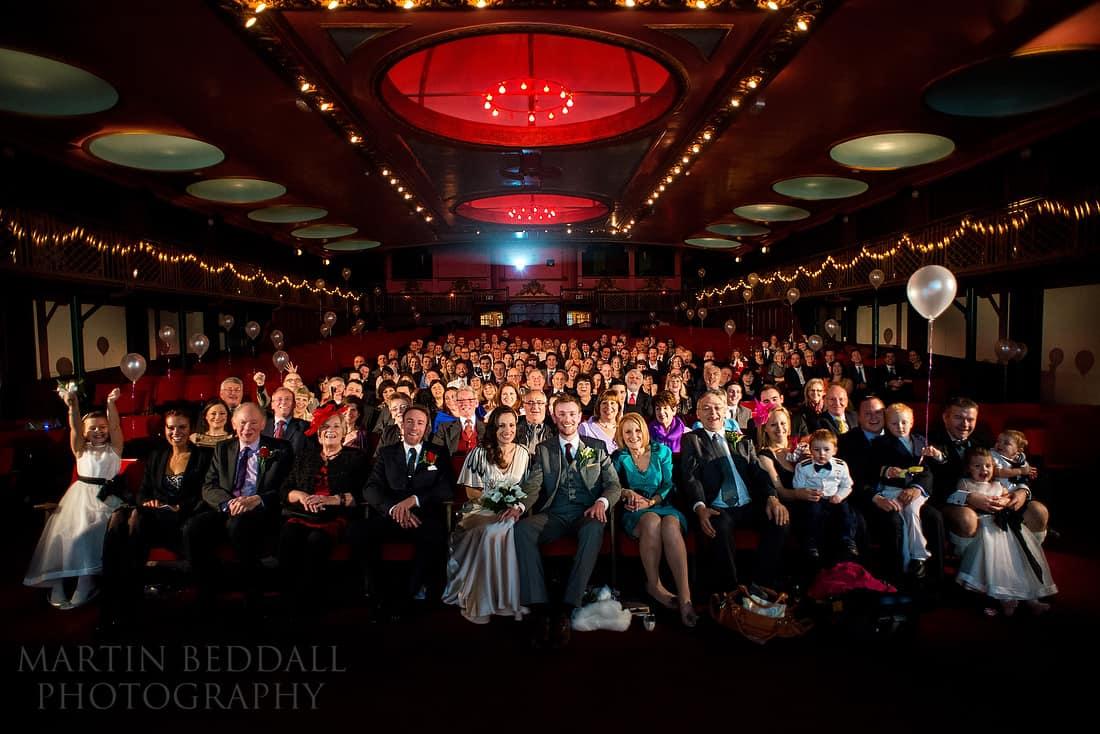 Wedding group shot in a cinema
