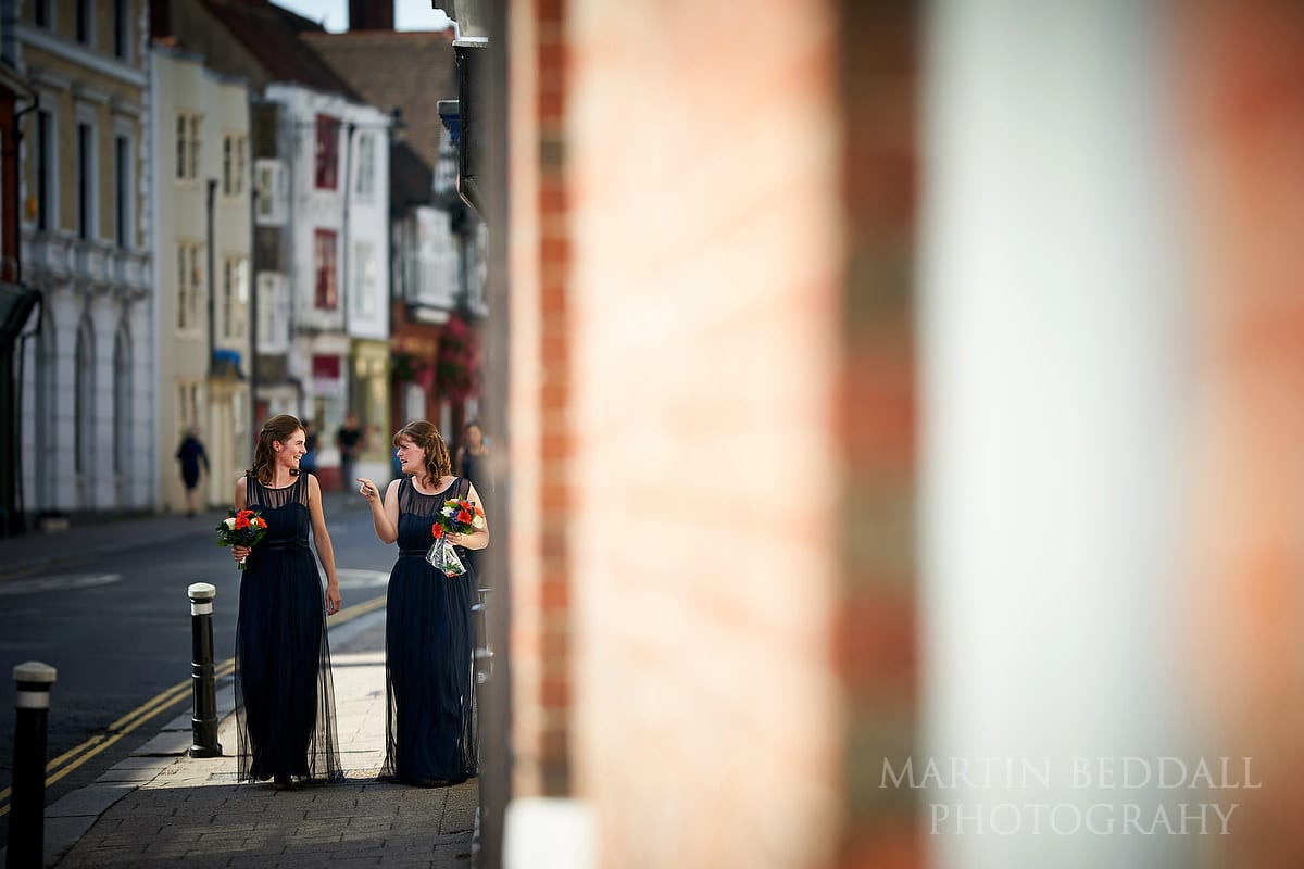 Two bridesmaids walking down Lewes High Street