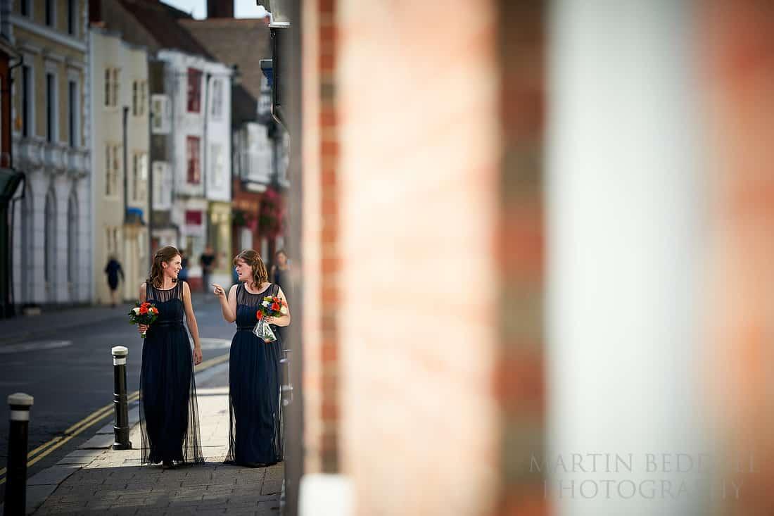 Bridesmaids walk down Lewes high street