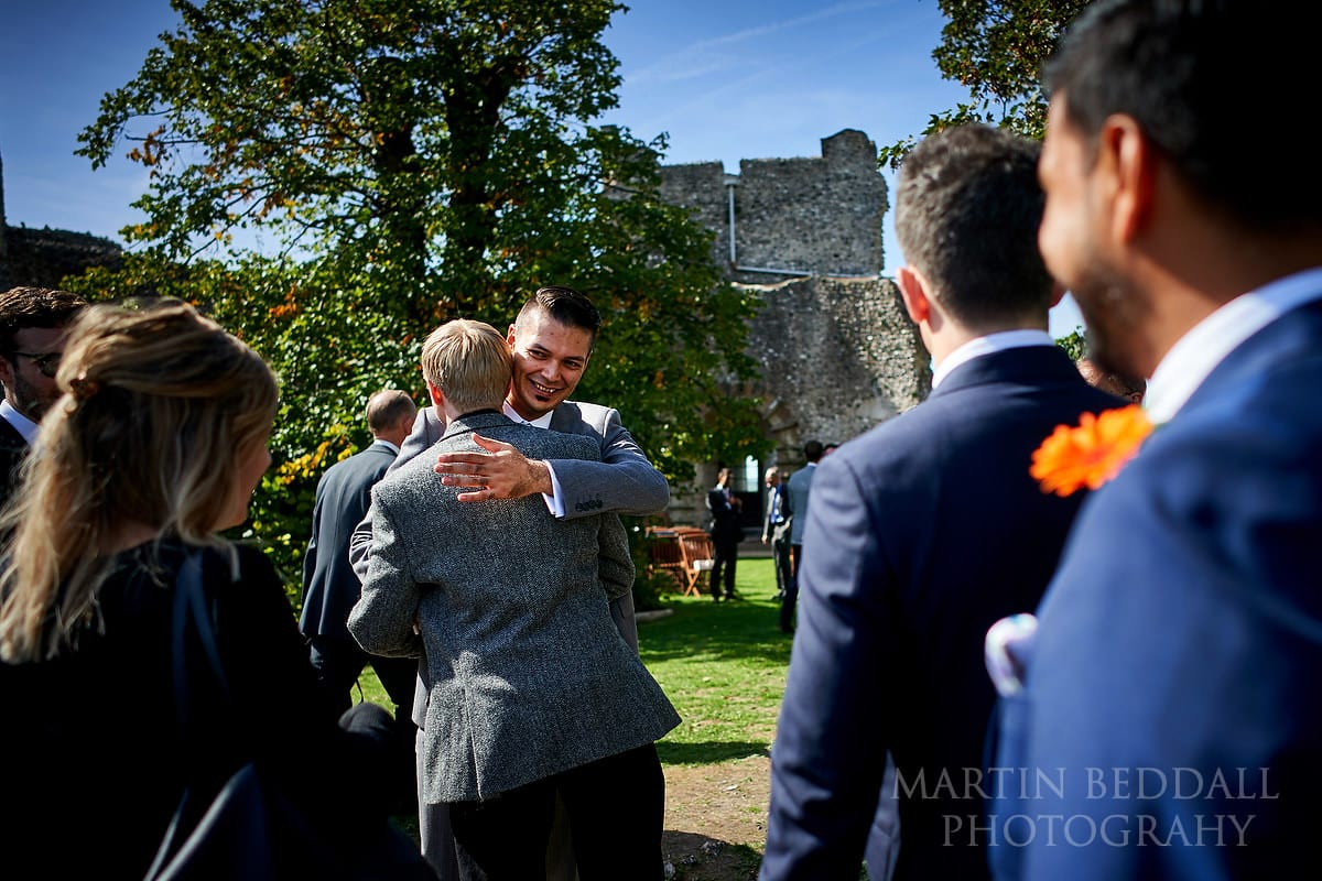Groom greets wedding guests at Lewes Castle
