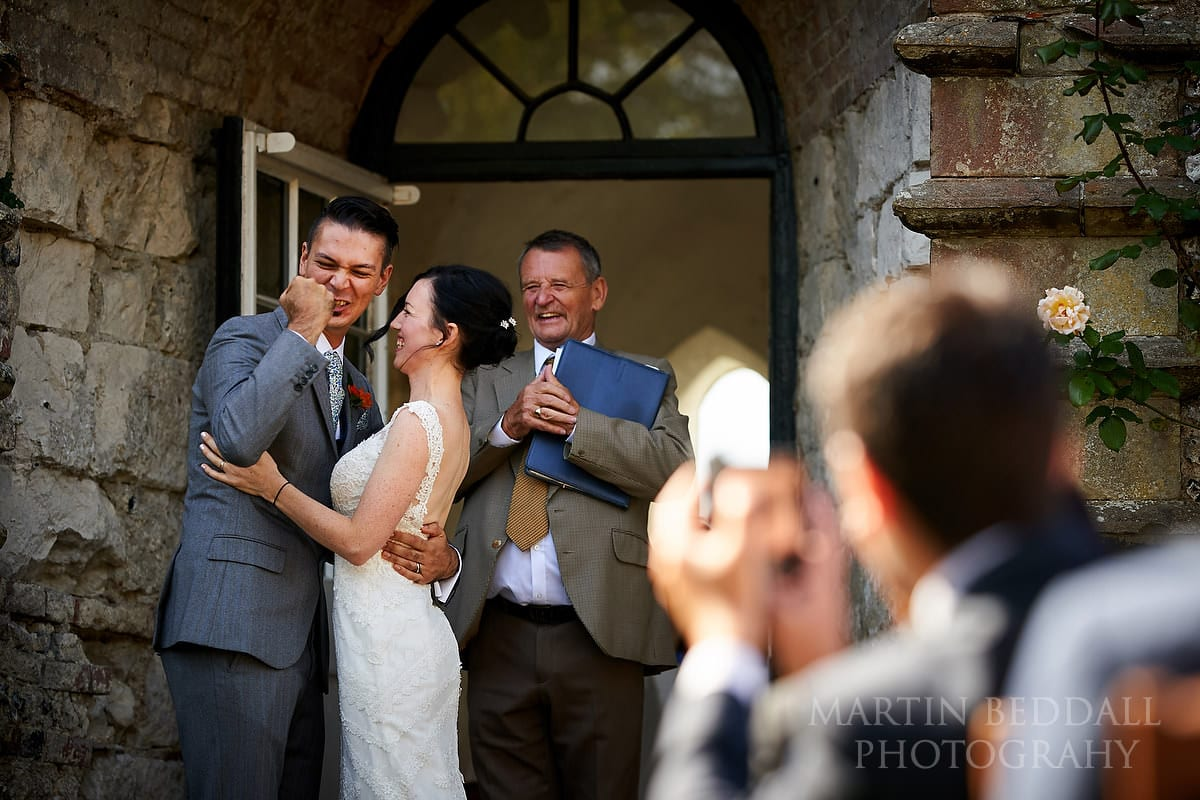 Groom punches the air