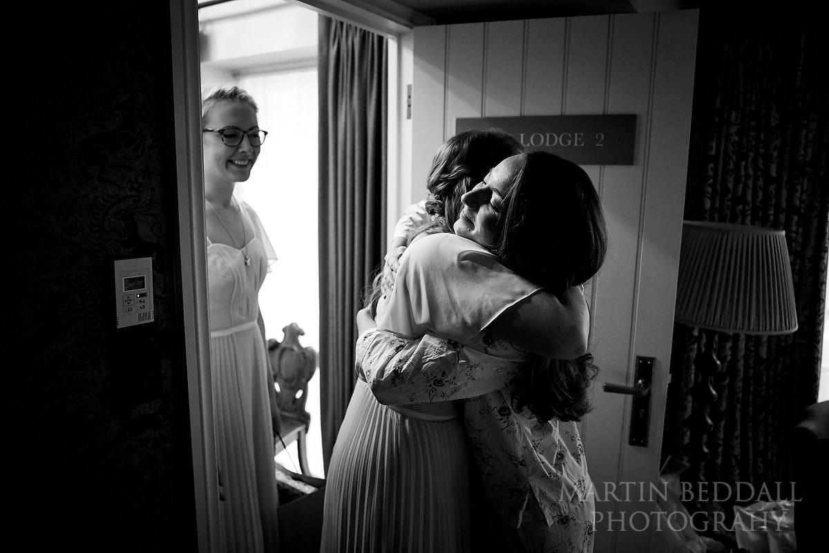 Bride greeting her bridesmaids