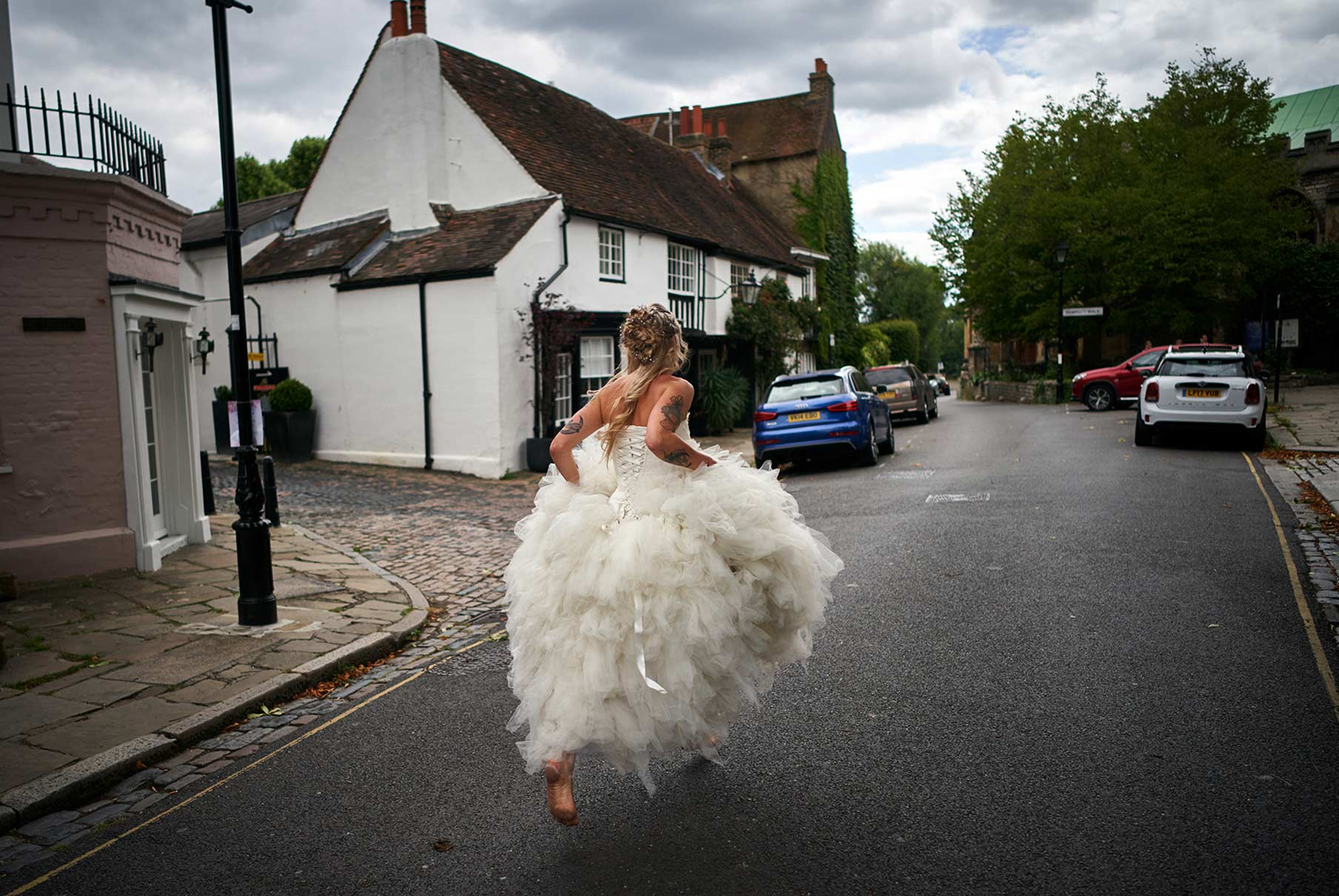 Barefoot bride running to the church