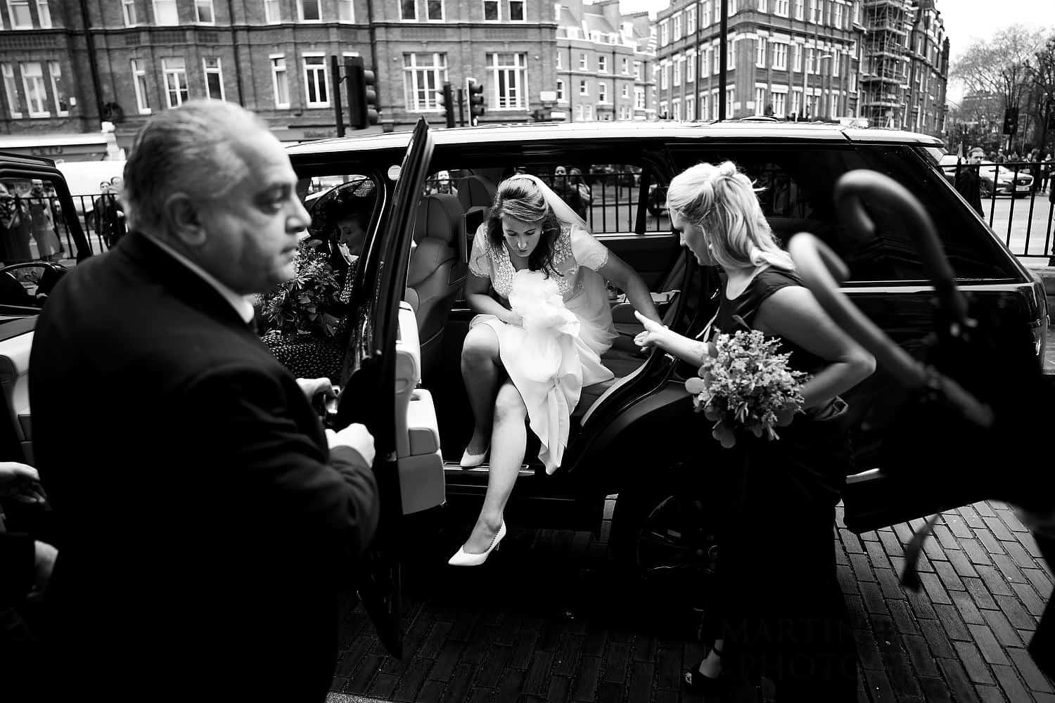 Bride leaves the wedding car at Brompton Oratory