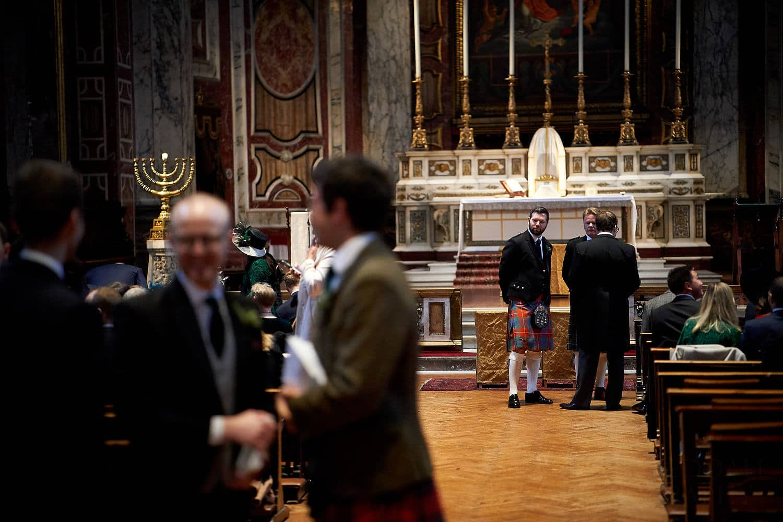 groom waits in Brompton Oratory