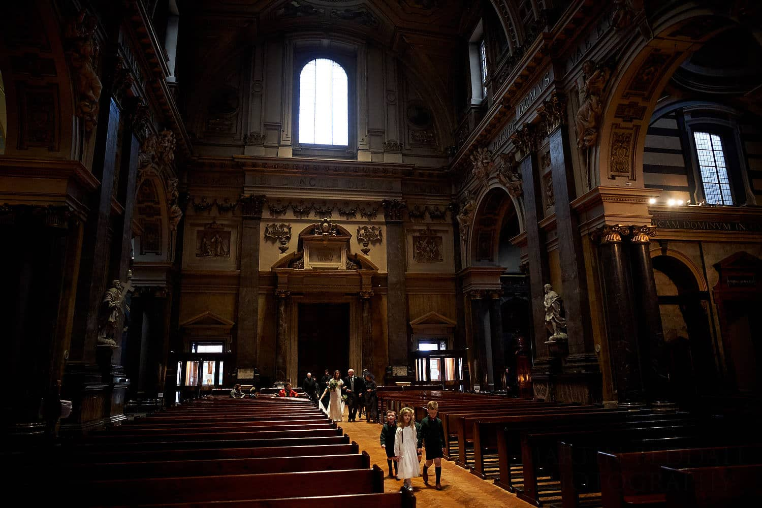 Bride walks down the aisle at Brompton Oratory