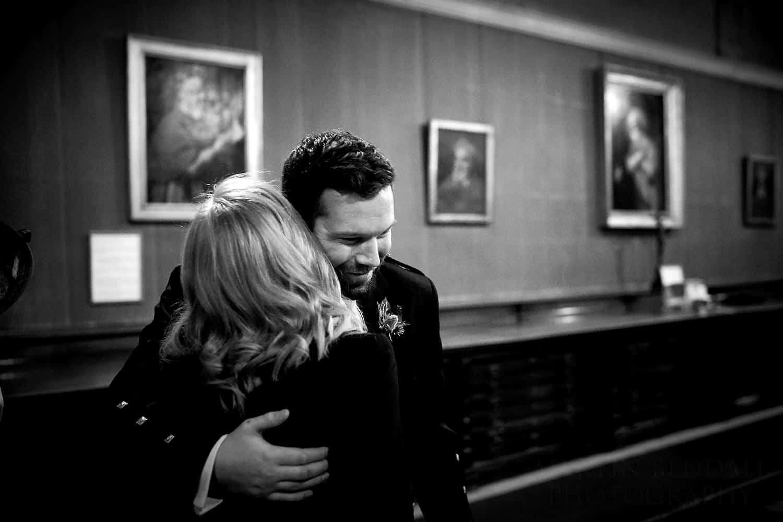groom hugs his mother