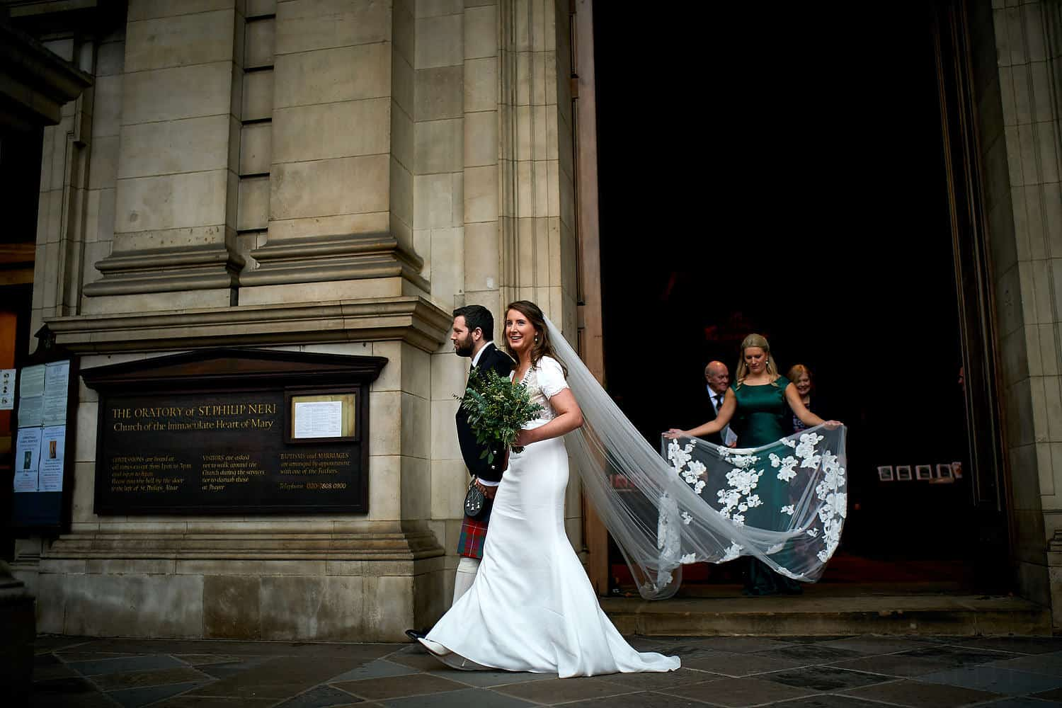 bride and groom leave Brompton Oratory