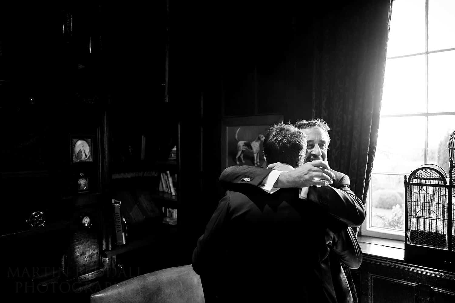 groom and his father hug