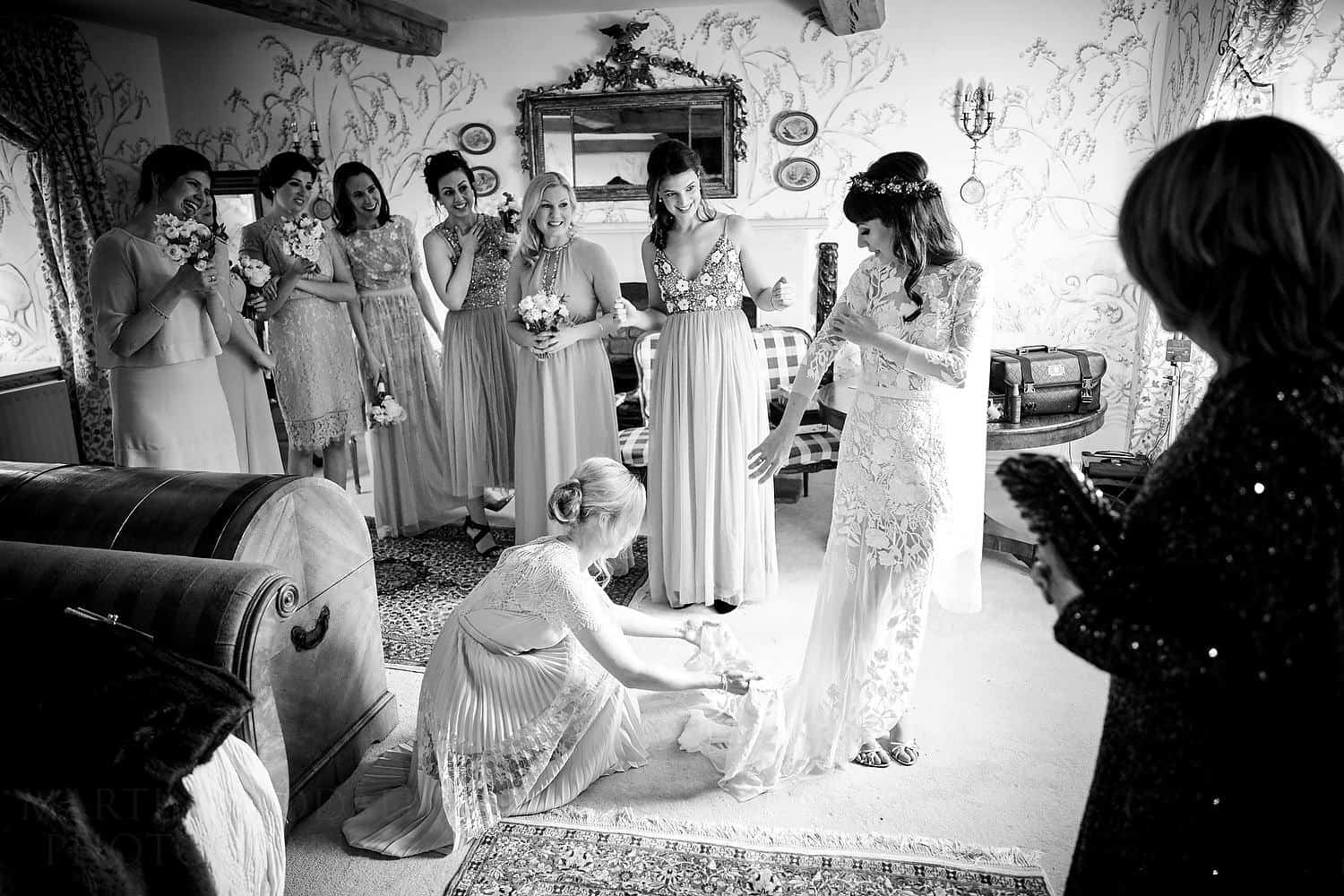 showing the wedding dress to the bridesmaids