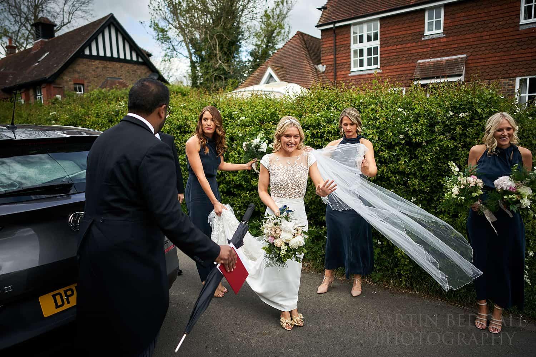 Bride waves to flower girl