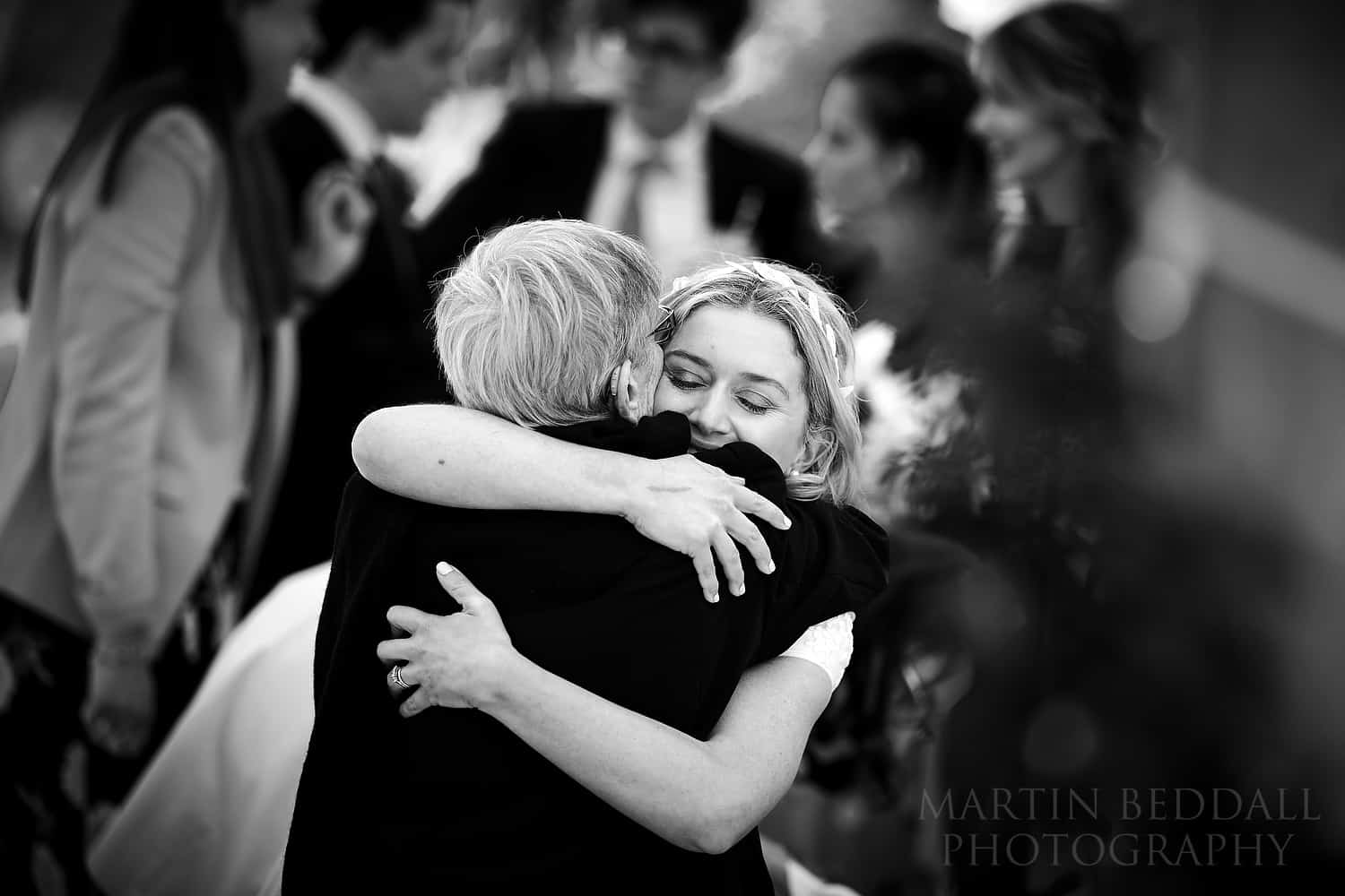 bride hugs her grandmother
