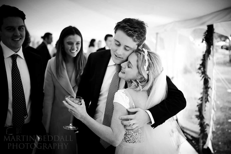 Bride hugs her brother