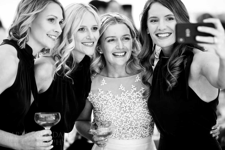 Bride has a selfie with the bridesmaids