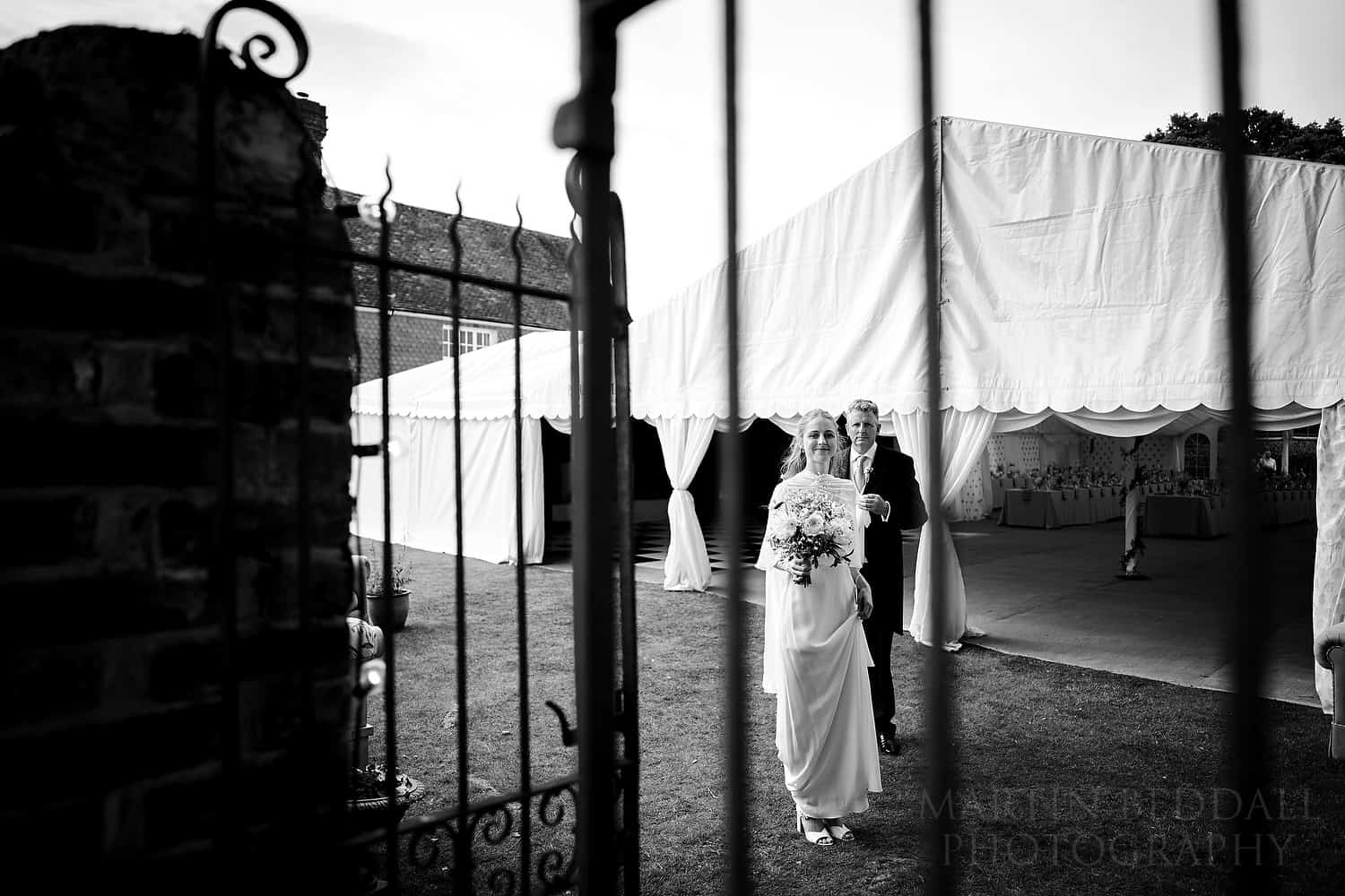Bride and her father wait