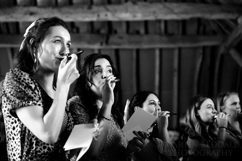 bridesmaids play their kazoos