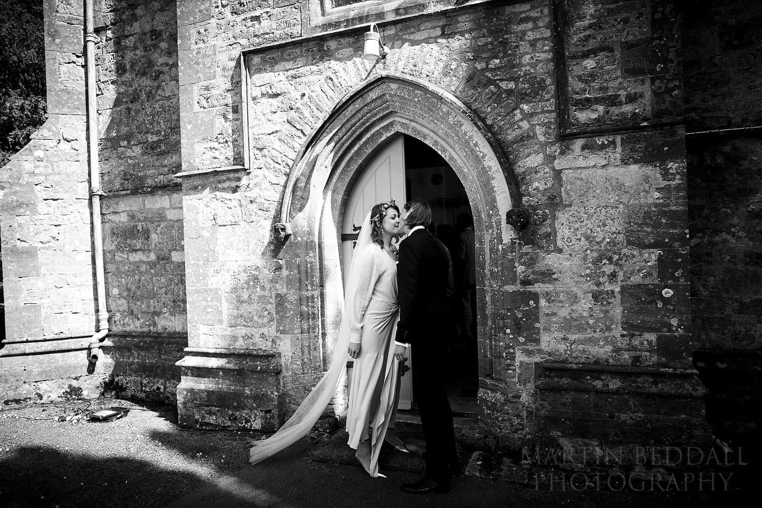Kiss outside the church