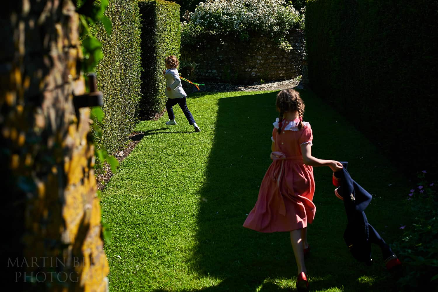 Kids playing in the grounds of Plush Manor