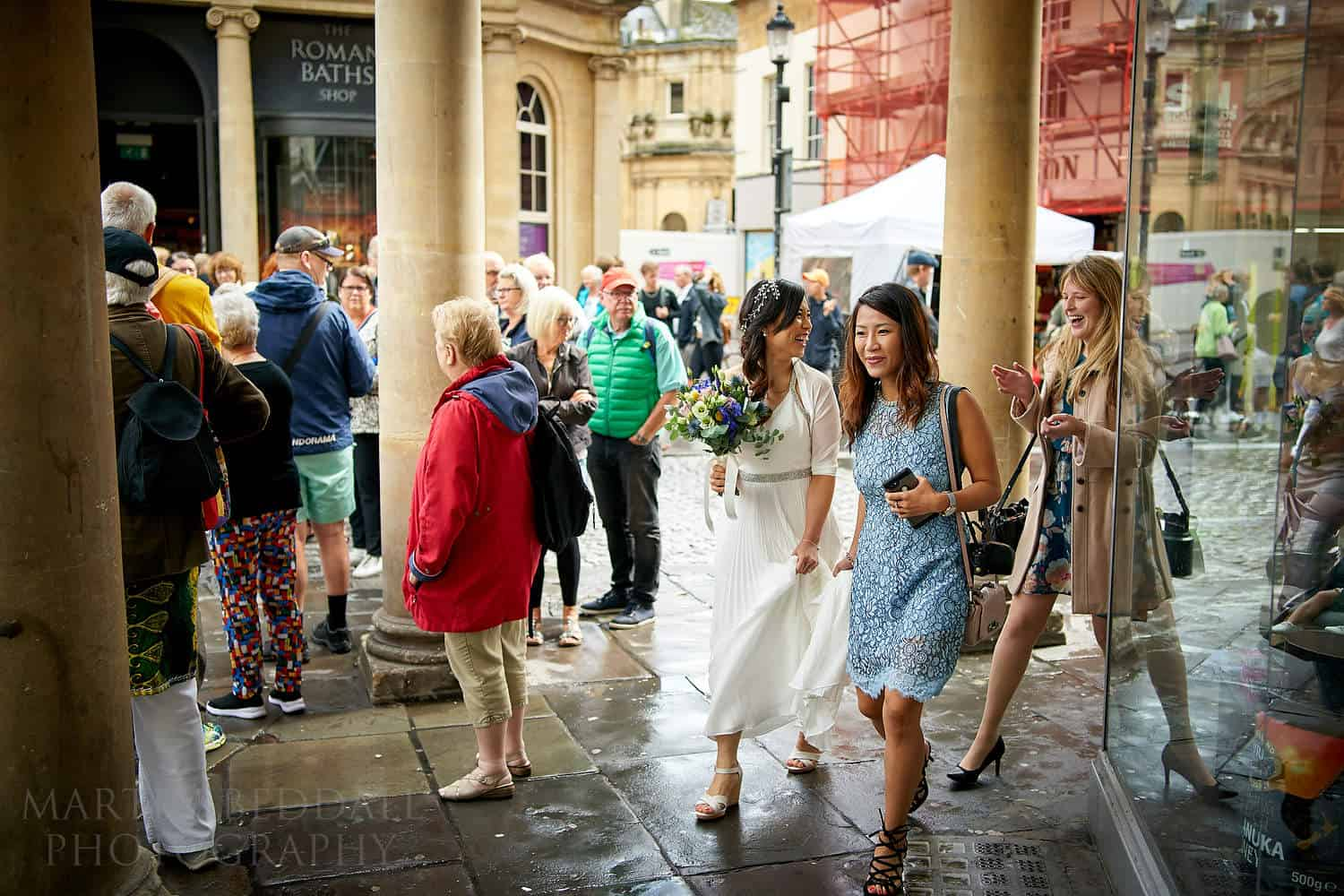 Bride walking through Bath to the wedding venue