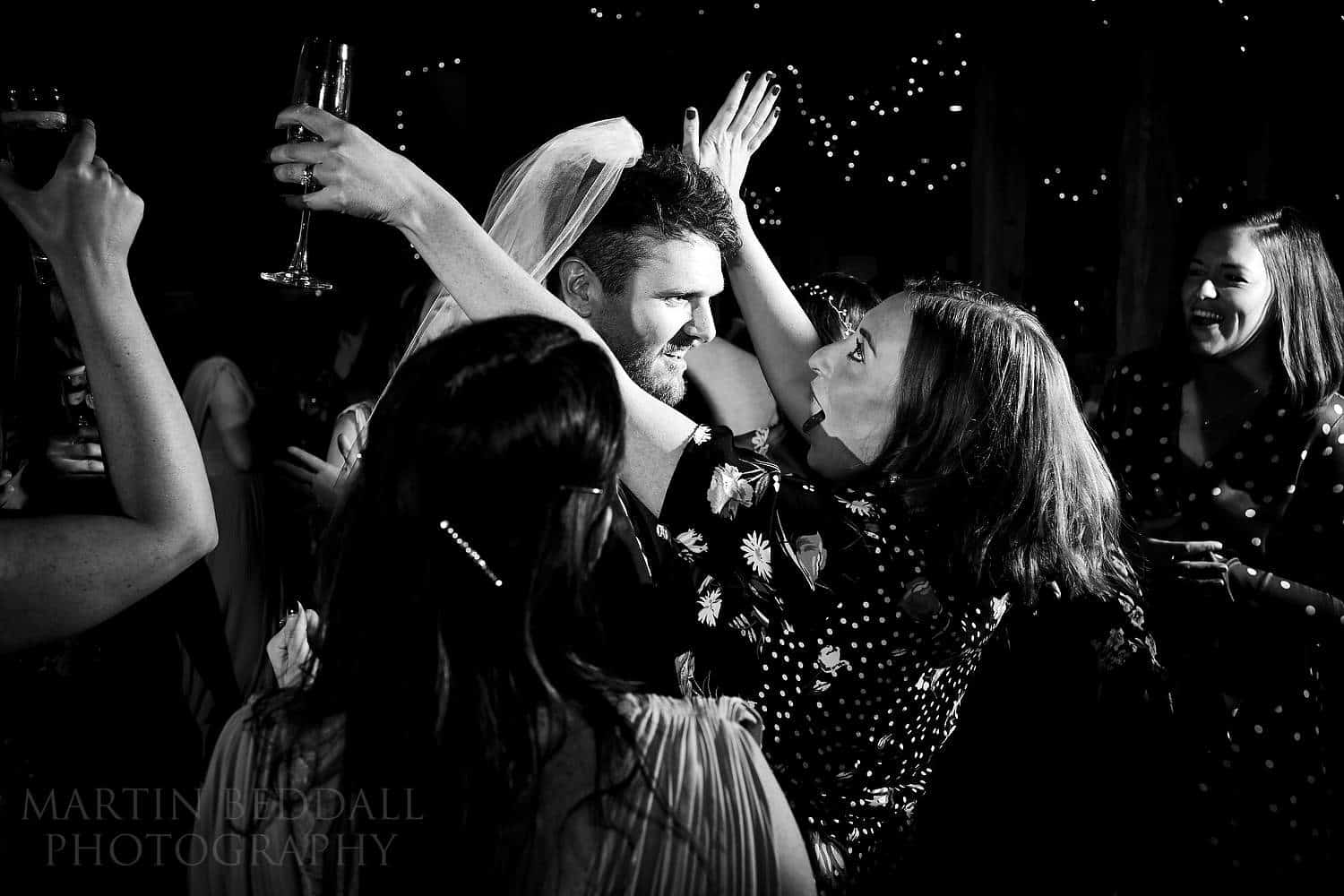 Groom mobbed on the dance floor