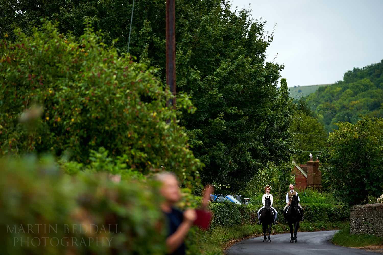 Bride arrives on horseback