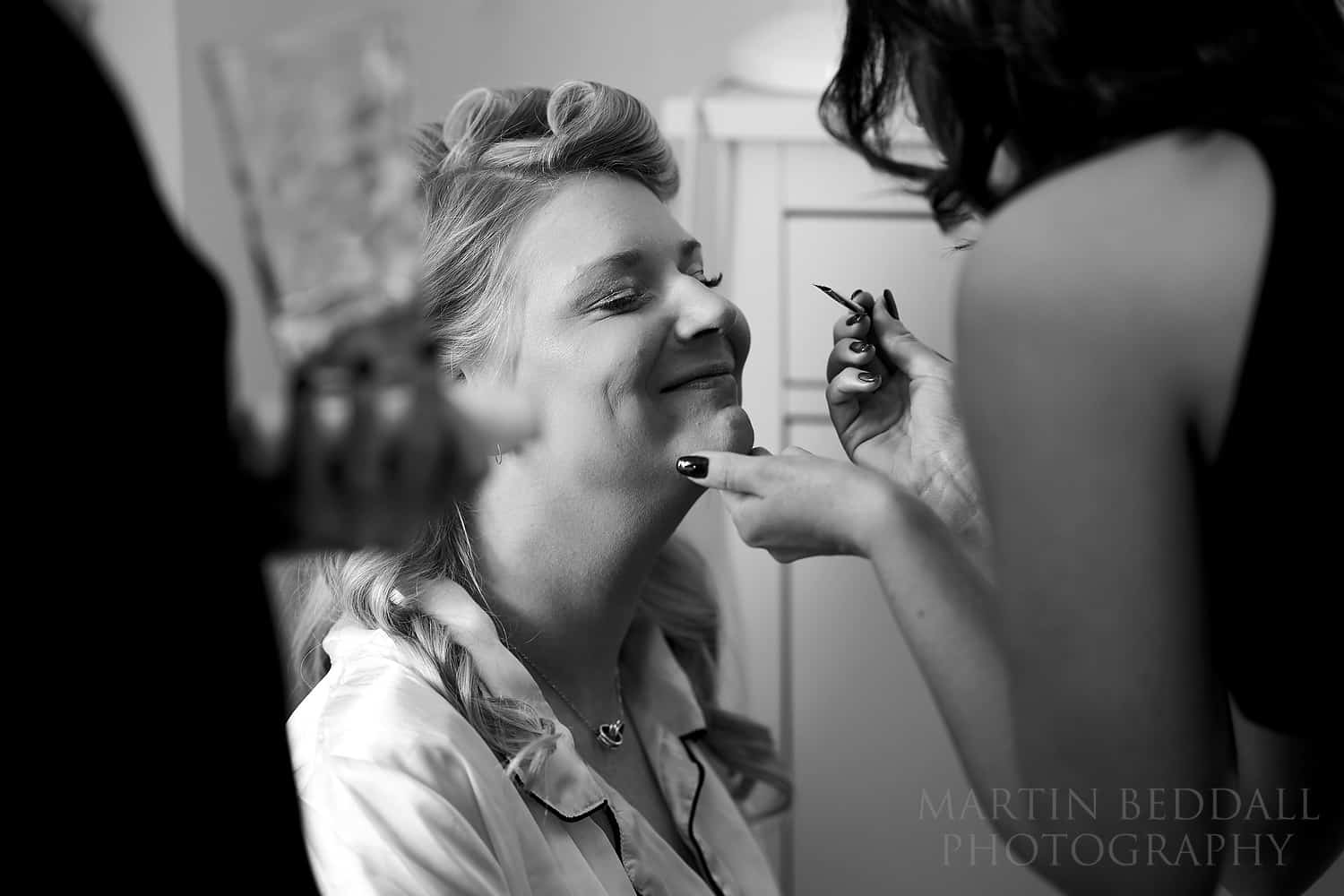 Smiling bride in makeup