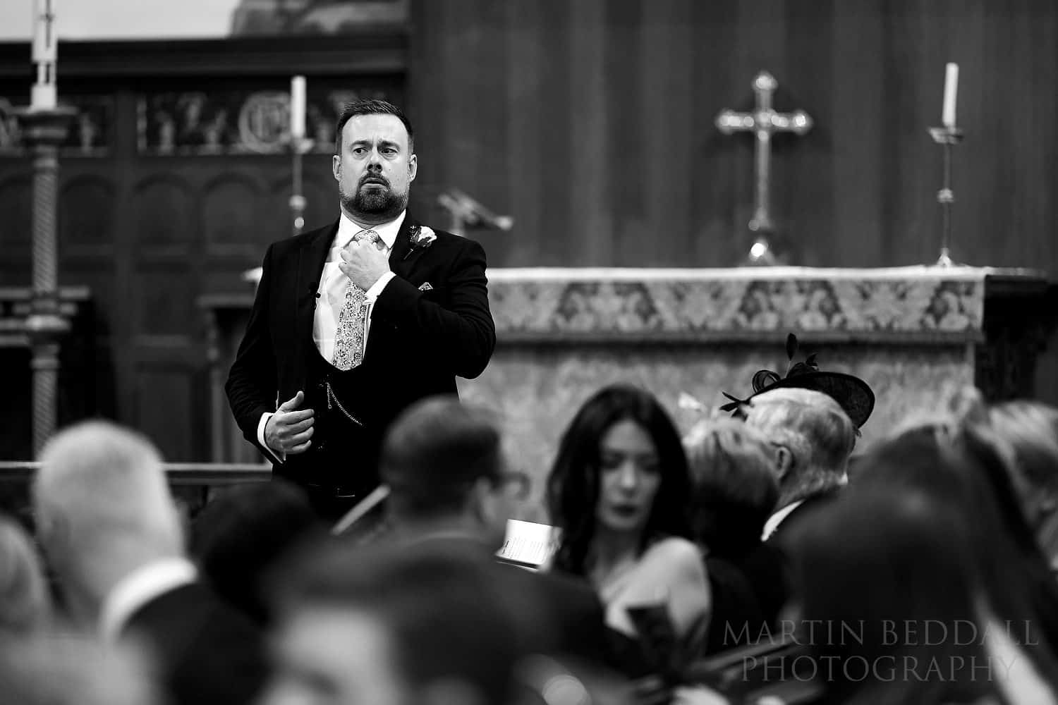 Groom waits in the school chapel