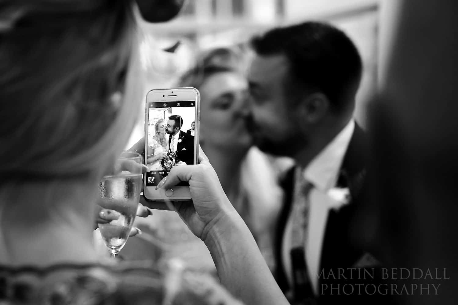 Iphone picture of bride and groom kissing