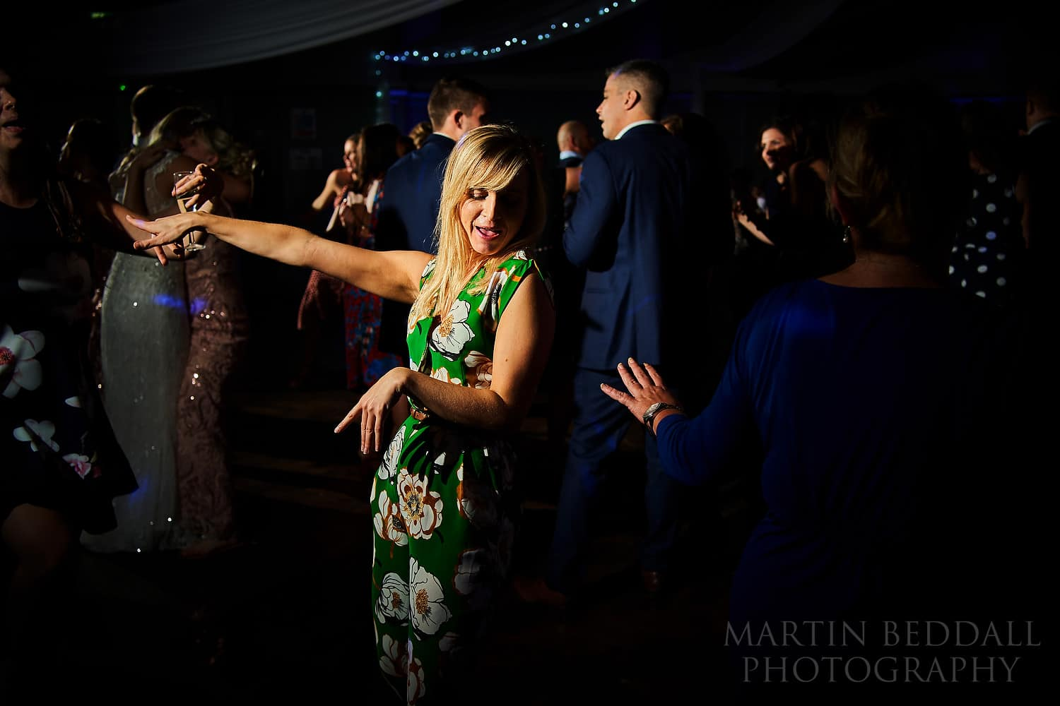 Pretty wedding guest dancing